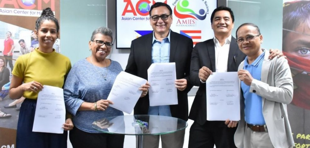 ACM FORGES TIES WITH PUERTO RICO'S AMIES INTERNACIONAL
